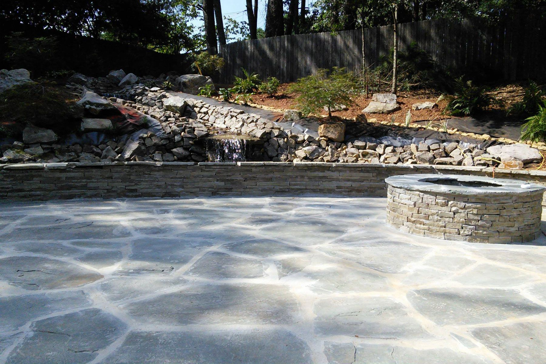 stone patio with water feature